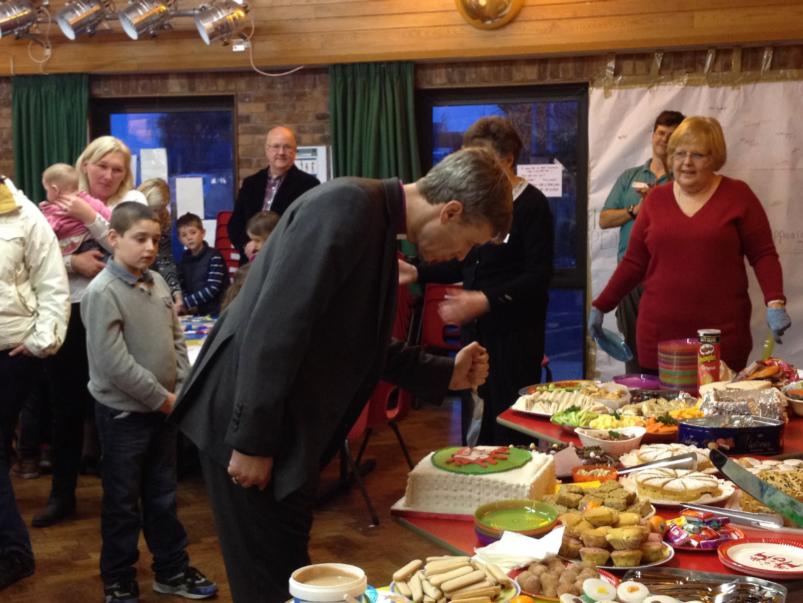 Bishop Tim cutting the cake